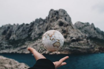 Hand throwing globe