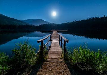 Lake dock in moonlight