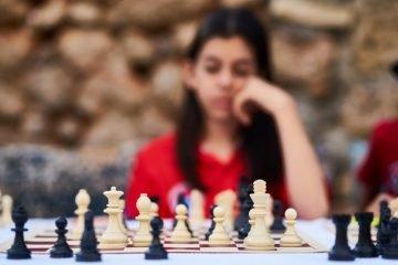 Girl at Chess Board
